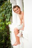 Cute kid sitting on porch Stock Image
