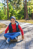 Cute kid skateboarding in nature Royalty Free Stock Photo