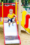 Cute kid on the slide Stock Images