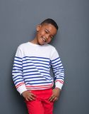Cute kid smiling with hands in pocket Stock Photos