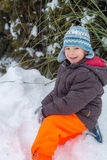 Cute kid on the snow stock image