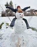 Cute kid and snowman Stock Photo