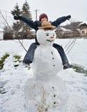 Cute kid and snowman Stock Photo