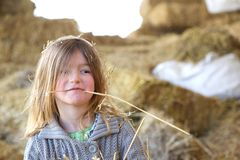 Cute kid with straw in mouth Stock Images