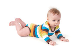 Cute kid in a striped body lying on his tummy Royalty Free Stock Photography