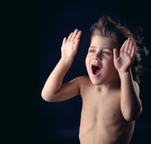 Cute kid with surprised expression acting funny Stock Image