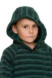 Cute kid in sweater, isolated on white. Cute serious boy in green sweater, isolated on white background Stock Images