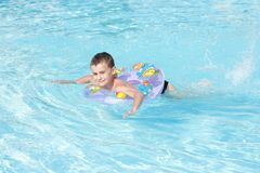 Cute kid swimming in pool royalty free stock image