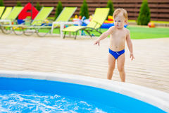 Cute kid by the swimming pool Royalty Free Stock Images