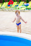 Cute kid by the swimming pool Royalty Free Stock Image
