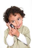 Cute kid talking on a cell phone Royalty Free Stock Photo