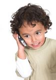 Cute kid talking on the phone Royalty Free Stock Image
