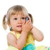 Cute kid talking on smart phone. Stock Photos