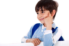 Cute kid thinking. And looking sideways on isolated white background Royalty Free Stock Photo