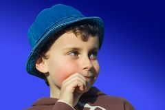 Cute kid thinking Royalty Free Stock Image