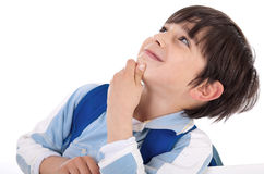 Cute kid thinking and looking up Royalty Free Stock Photography