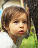 Cute kid thinking outdoors Royalty Free Stock Photo