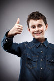 Cute kid thumbs up Royalty Free Stock Photo