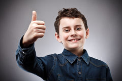 Cute kid thumbs up Stock Photography
