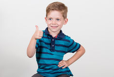 Cute kid thumbs up. Cute kid smiling and thumbs up Royalty Free Stock Photography