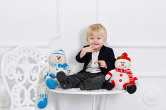 Cute kid and two snowmen Stock Photo