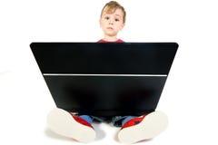 Cute Kid using computer royalty free stock image