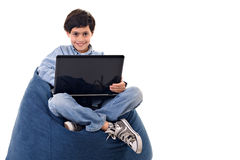 Cute kid using a notebook Stock Images