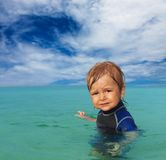 Cute kid in wetsuit Stock Photos