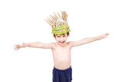 Cute kid with wheat hat on head. With hands up Royalty Free Stock Images