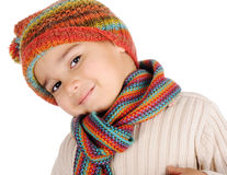 Cute kid with winter clothes. In studio Stock Images