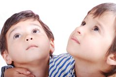Cute kids. Eyes look face expression up Royalty Free Stock Photos