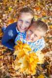 Cute kids with autumn leaves Royalty Free Stock Image