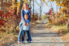 Cute kids in autumn park Royalty Free Stock Photo