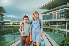 Cute kids with backpacks. Walking back to school Royalty Free Stock Photo
