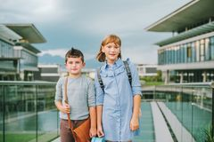 Cute kids with backpacks. Walking back to school Royalty Free Stock Photography