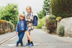 Little kids portrait. Cute kids with backpacks walking to school Stock Photography