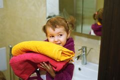 Cute kids in bathrobes in the bathroom Royalty Free Stock Photo
