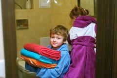 Cute kids in bathrobes in the bathroom Royalty Free Stock Photos