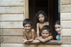 Cute brazilian kids behind window royalty free stock images