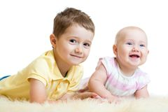 Cute kids brother and sister lying on floor Royalty Free Stock Image