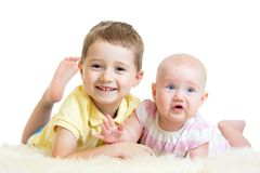 Cute kids brother and sister lying on floor Royalty Free Stock Photography