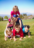 Cute Kids Building a Human Pyramid Royalty Free Stock Image