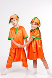 Cute kids in carrot fancy dress Royalty Free Stock Image
