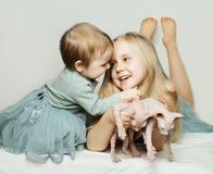 Cute kids and cats Stock Image