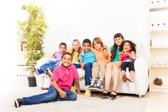 Cute kids on a couch Stock Photo