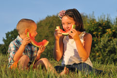 Cute kids eating Watermelon stock photos