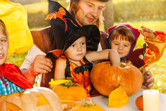 Cute kids and father in Halloween costumes Stock Photo