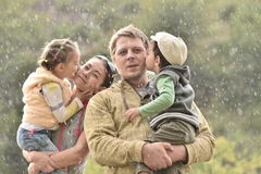 Happy family and cute kids on there hands in natur Royalty Free Stock Images