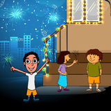 Cute kids for Happy Diwali celebration. Cute little kids enjoying and celebrating with firecrackers on shiny urban city background for Indian Festival of Lights Royalty Free Stock Photography