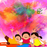 Cute kids for Indian Festival, Holi celebration. Cute little kids enjoying on occasion of Indian Colour Festival, Holi celebration on colourful background Stock Image
